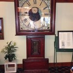 Huge antique wooden clock in lounge