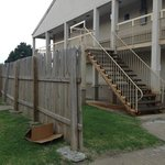 Exterior of Hotel, fence to hide derelict motel next door