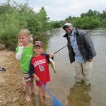 kids bass fishing on Black River in front of lodge