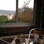 Breakfast table in conservatory, with view