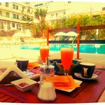 perfect breakfast by the pool - fresh orange juice, cappuccino, toasts and local bread with choc