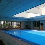 Quiet indoor swimming pool with grass area to sit outside