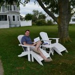enjoying the adirondack chairs facing the water
