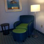 The very green vinyl chair in the king bed suite.