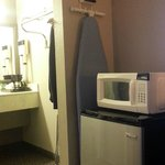 Fridge, microwave and ironing board