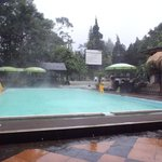 The main swimming pool in the hotel complex during some rain