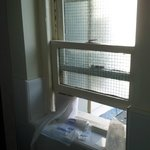 Old window requiring jamming open with toilet roll
