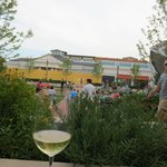 Herb garden overlooks children playing in fountain, live music at Bayshore Mall