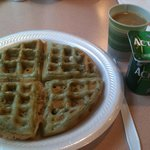 Yummy waffle breakfast accompanied by a cup of yoghurt & coffee