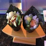 Spicy yellow tail hand roll and spicy tuna hand roll
