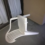 broken chair left on balcony sharp pieces all about