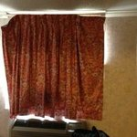 Those attractive curtains you see in other photos..they don't open.  At all.