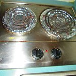Kitchenette stove top....nice drip pans