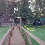 Wooden bridge from office to larger cabins and Lodge