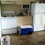 the kitchen ( cooler and cups are ours) the small appliances were brand new. Refrigerator looks