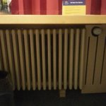 Radiator propped up by wood