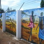 Masaai pictures on the wall fence