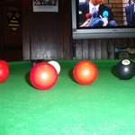 Pool table and 1 of 2 televisions at The Brave Old Oak