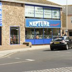 Located on a roundabout with a large car park with facilities opposite