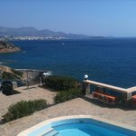 During the day - part of the swimming pool, the view and Agios Nikolaos in the background!