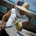 Lloyd chopping away at the coconut