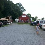 The parking lot and entrance, beer in the red building and BBQ on the left of it