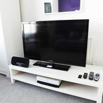 """Deluxe King Room with 46"""" TV, all Sky Channels, DVD player, ipod/pad docking station & seating"""