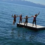 Girls having fun jumping off floating dock!