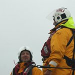Lifeboat crew returning from rescuing fishing boat