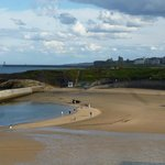 Cullercoats beach with Priory in the distance