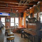 3. Lodge with historical artifacts, tables, and piano