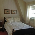 Room 7: Double bed and ensuite bathroom, two chairs, closet, chest of drawers