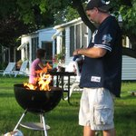 My husband cooking out,Grills and lighter fluid,Charcole provided
