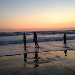 The kids, enjoying some waves at dusk