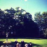 Grandchildren releasing balloons in gardens