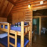 Log bunk beds in one of the Cozy Cabins