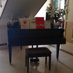 Lovely piano in the foyer