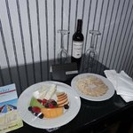 Complimentary wine and cheese/fruit plate