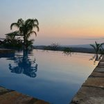Swimming pool by sunset with