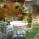 This is the very pretty private covered garden area