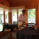 Barbara setting up breakfast in the sunroom
