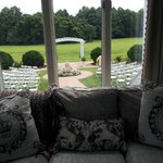 Patio out back w/ comfy sofa. (The chairs are set up for a wedding)