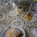 Delicious scone with cream and lemon curd