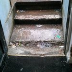 Guest's rear entrance - worn steps, dirty carpet