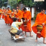 monks parading in front of the guesthouse