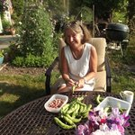 Sue shelling beans in the garden