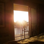 Watching sunrise from bed