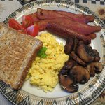 Bacon and Eggs, with mushrooms and tomatoes and served with Toast