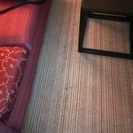 Carpet stains in front of couche
