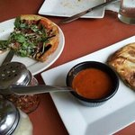 Arugula and pepperoni pizza; marinated vegetable calzone